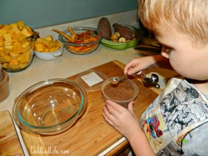 Measuring during Fall Pumpkin Soup with Children used for indoor activities at ChildLedLife.com