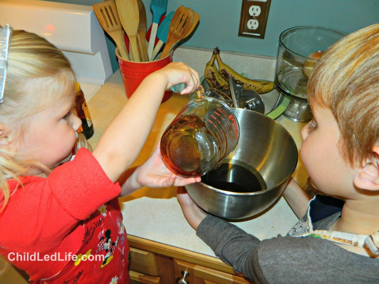 Kids love to help in the kitchen. Adding all the ingredients for #gingerbreadcookies is a fun way to get kids in the kitchen at ChildLedLife.com