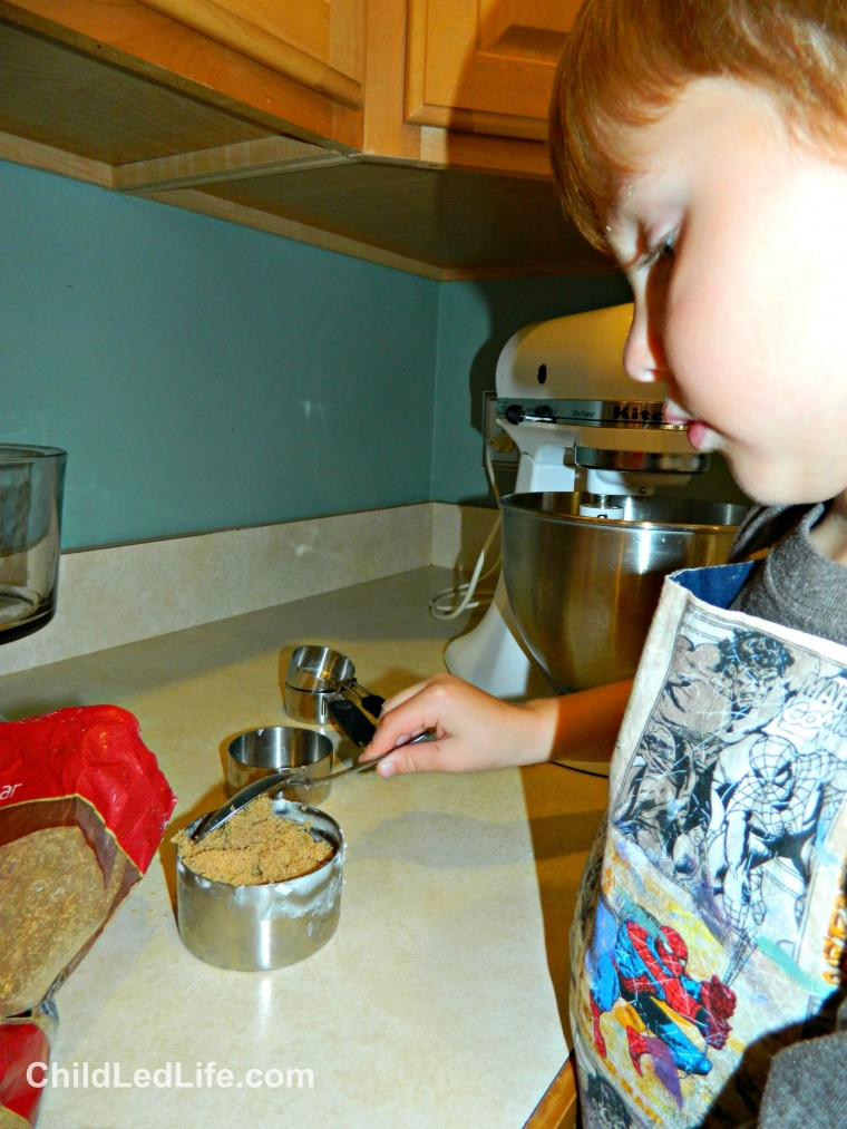 Do you love to help your kids in the kitchen? Our kids love to measure ingredients. Brown sugar is a key ingredient in our  #gingerbread cookies on ChildLedLife.com