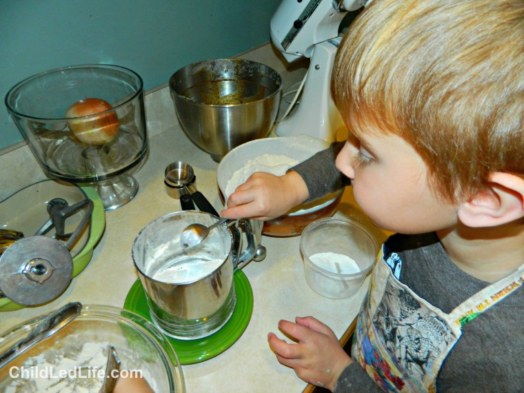 Measuring is something kids love to help with in the #kidskitchen. We added our baking soda to our gingerbread cookie recipe on ChildLedLife.com