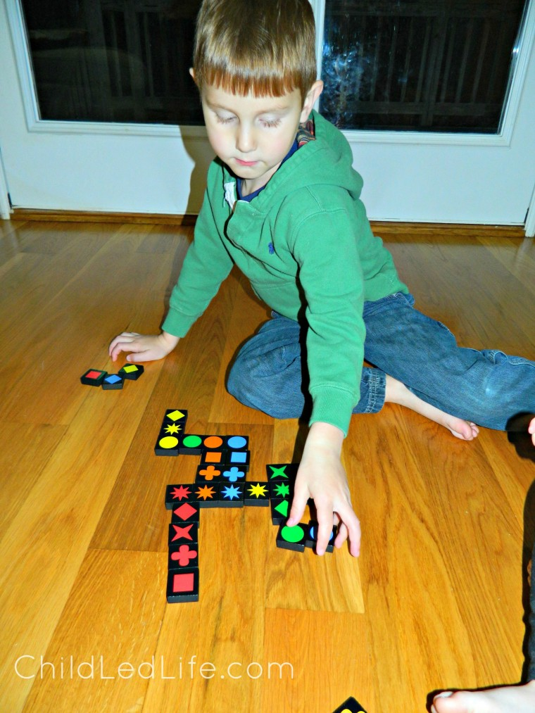 Must have game for your homeschool room! Qwirkle is fun for all ages. Preschoolers work on easy strategy and beginning game playing etiquette at ChildLedLife.com