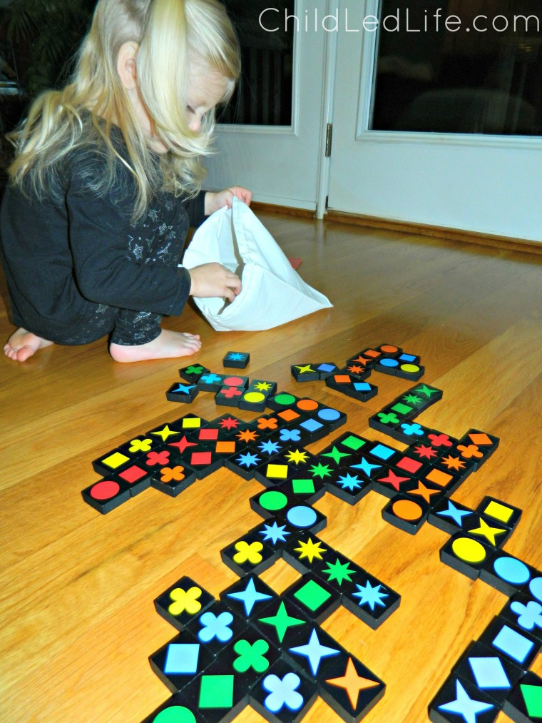 Must have game for your homeschool room! Qwirkle is fun for all ages. Toddlers can work on color and share recognition  and beginning game playing etiquette at ChildLedLife.com