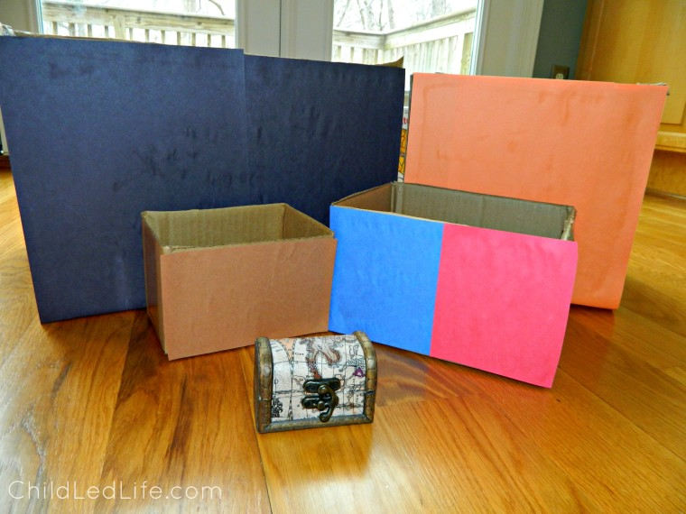 Recycled boxes with construction paper make easy geography boxes on ChildLedLife.com