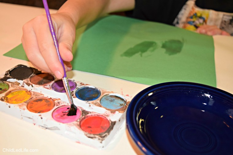 Exploring writing with watercolors and paintbrush